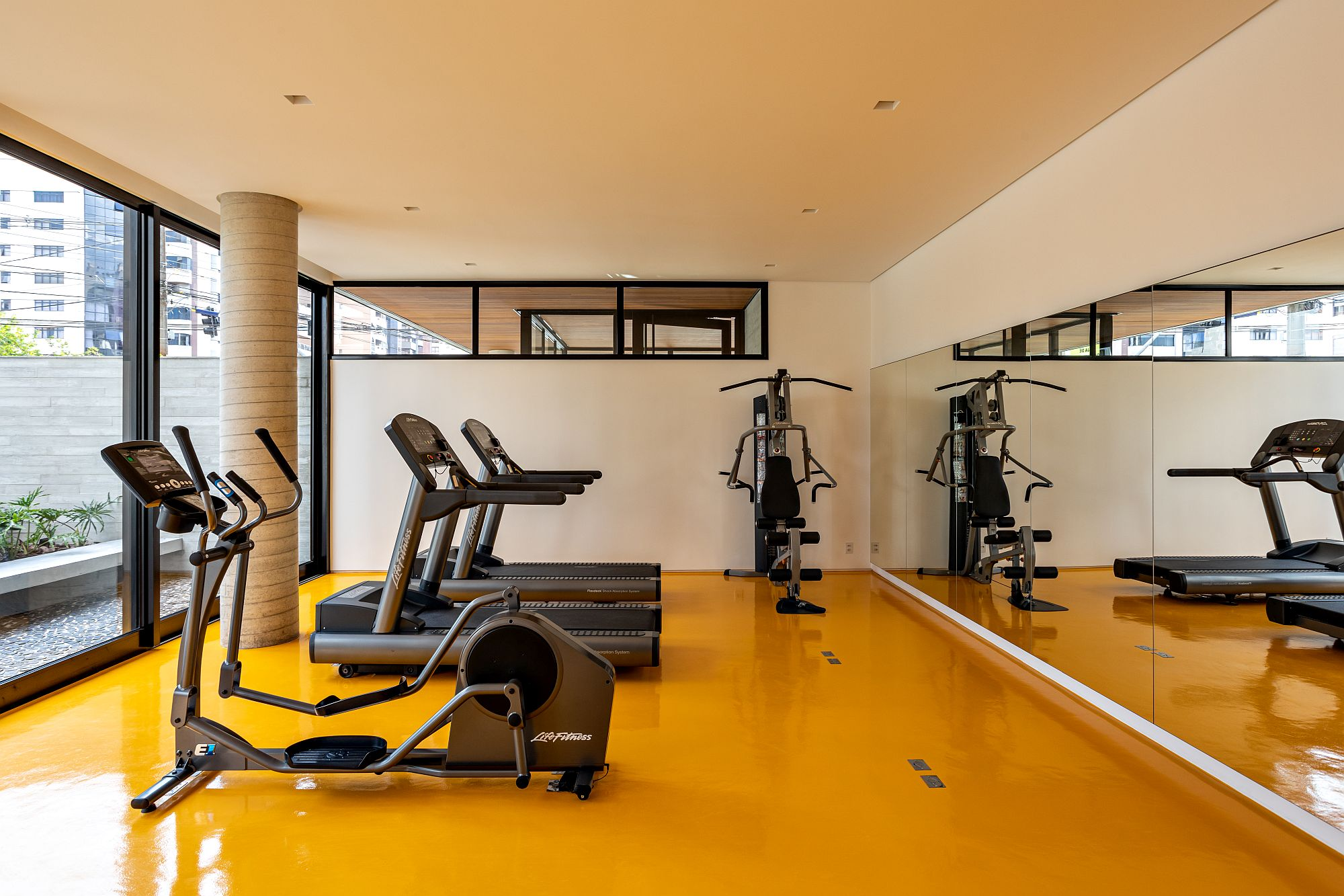 Bright and beautiful yellow floor of the gym area grabs your attention