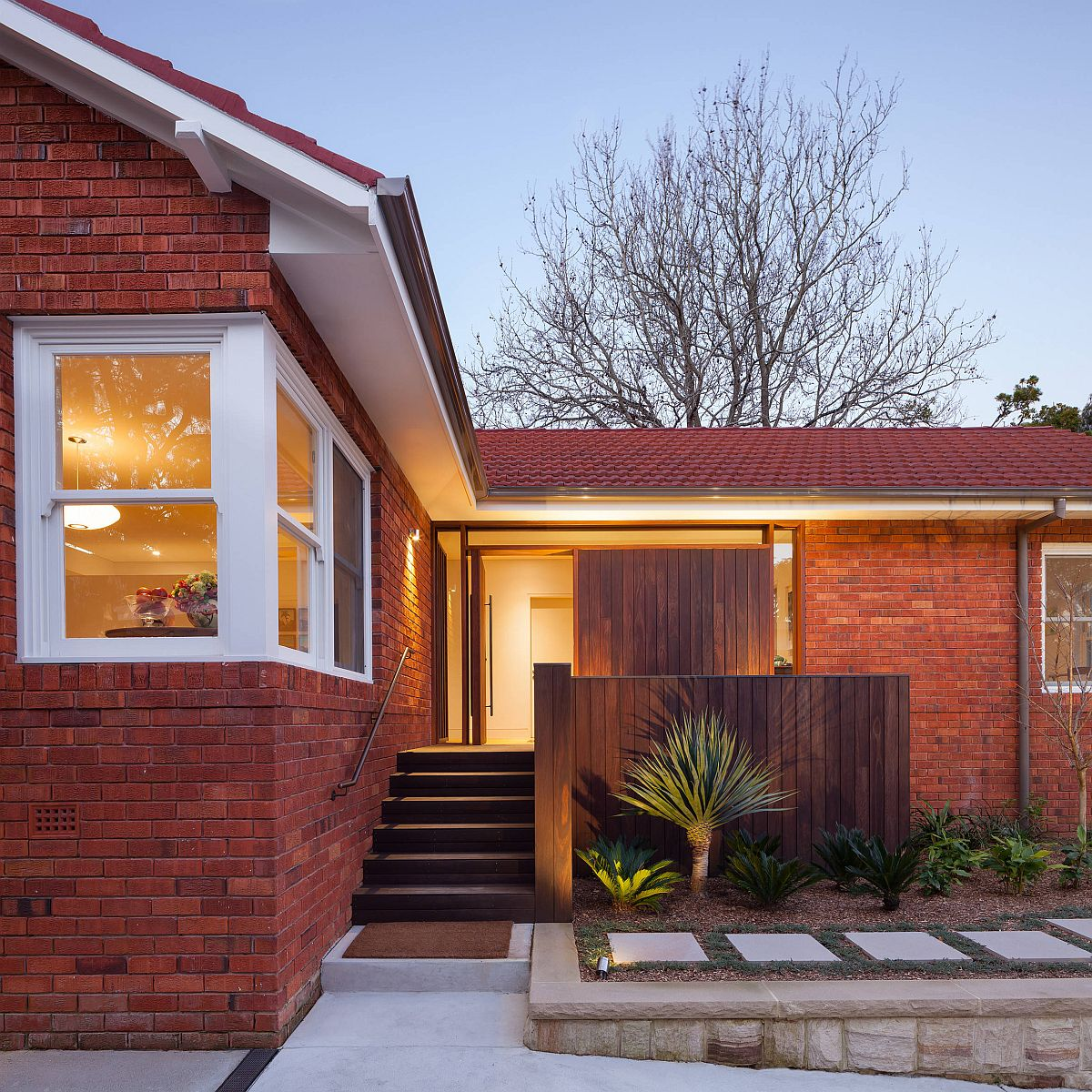 Classic brick walls give this home a comfortable redsheen while still keeping the facade modern
