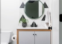 Contemporay-powder-room-in-black-white-and-graywith-hexagonal-tiles-in-the-backdrop-and-dark-hexagonal-floor-tiles-40854-217x155