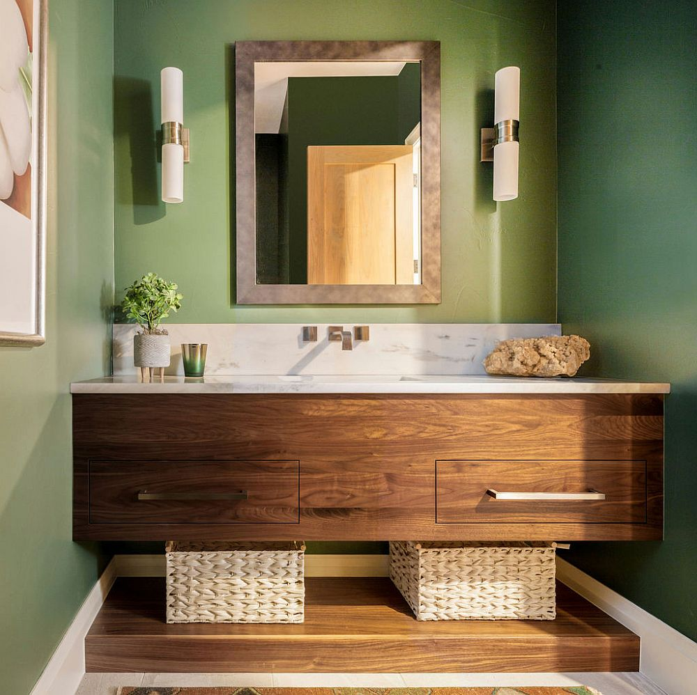 Custom wooden vanity with stone countertop and a light green backdrop for the powder room