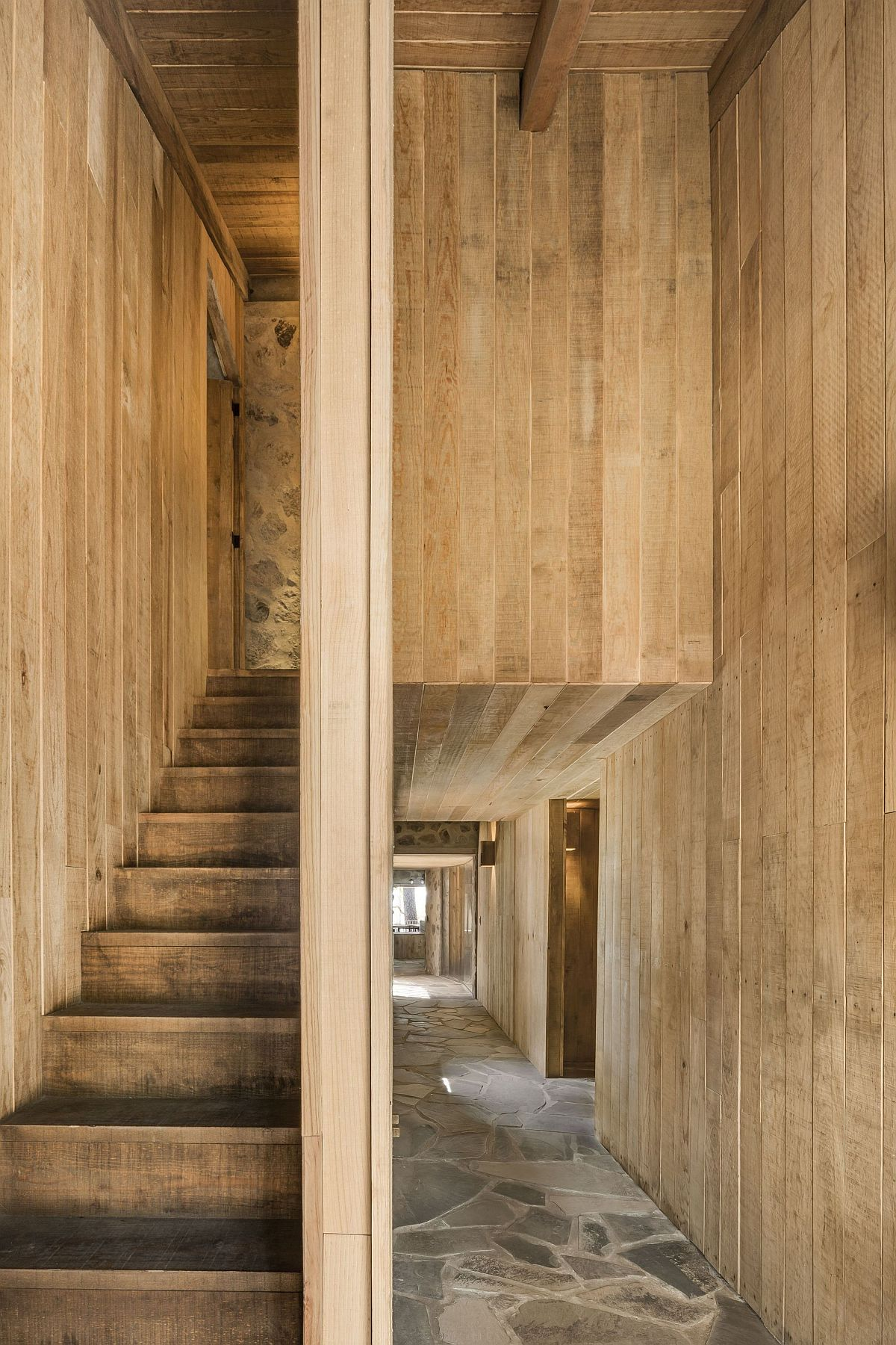 Custom wooden walls and staircase inside the cabin