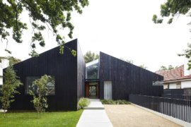 Cedar House: Dark, Dashing Exterior Conceals Cozy, Minimal Living Spaces