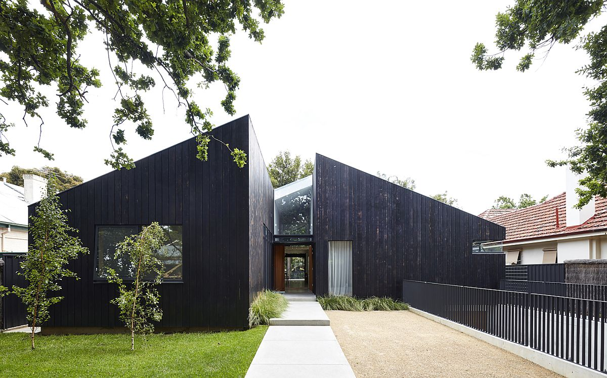 Dark charred cedar boards create distinct and modern exterior of the house