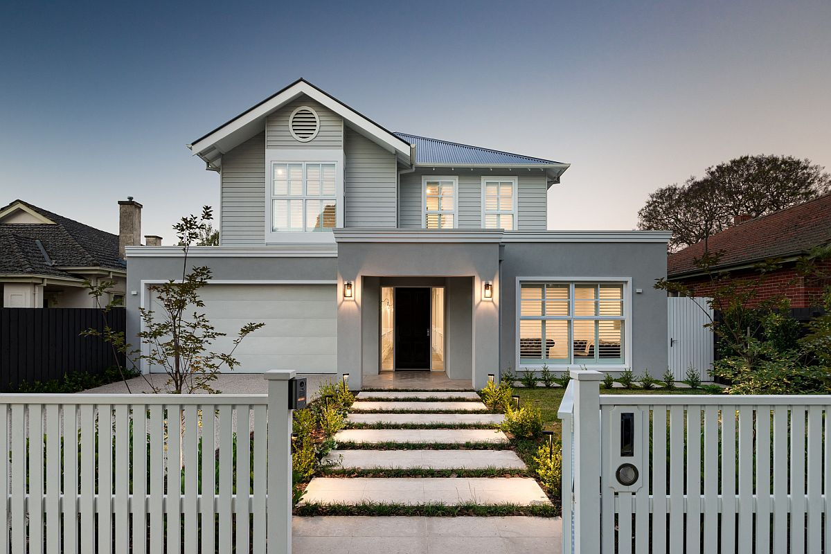 Delightful modern home facade with light gray walls and smart white trims