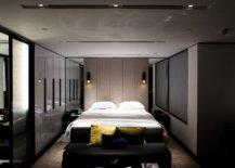 Modern bedroom with grey panel walls