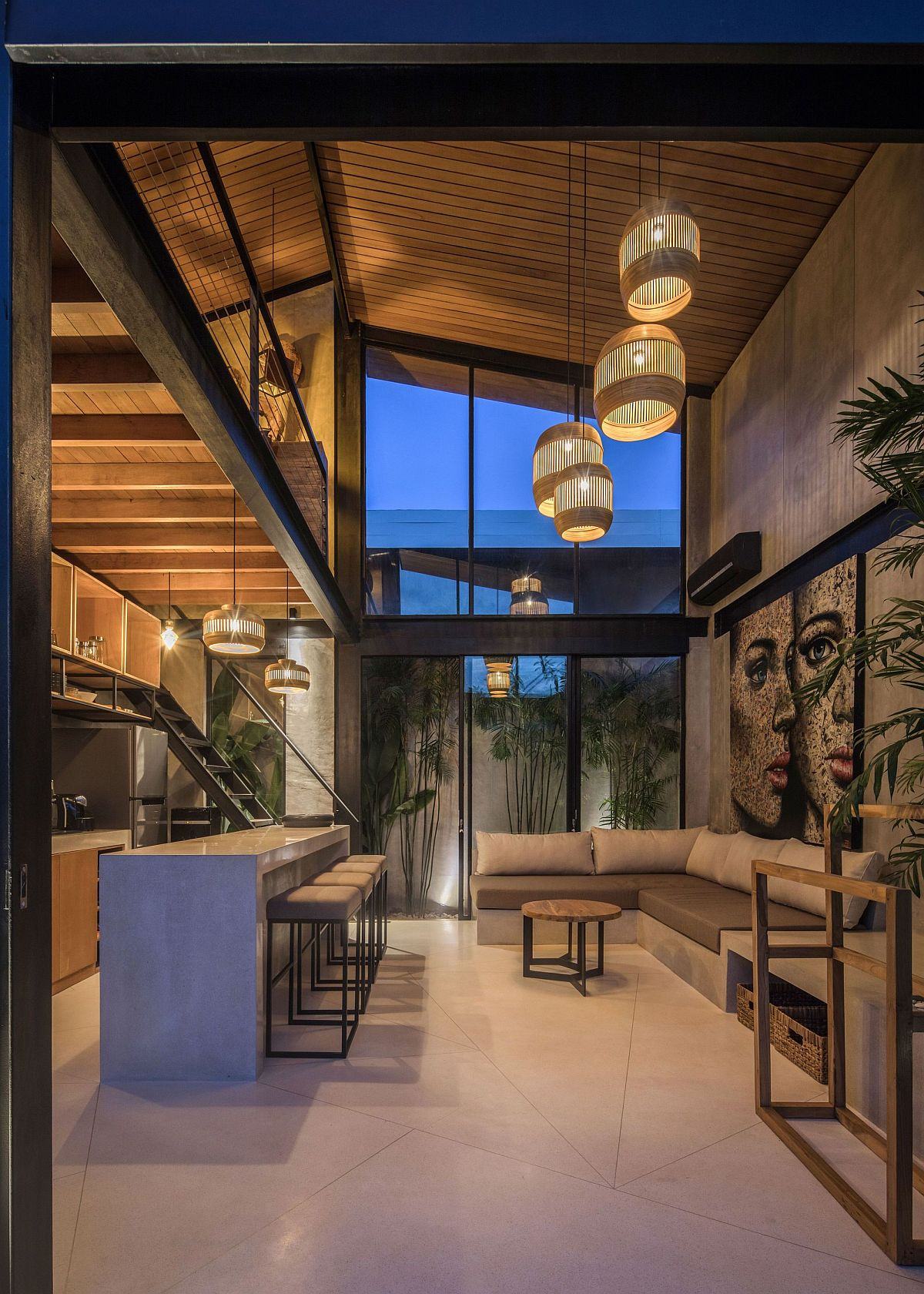 Double-height living area and kitchen of the house with fabulous lighting