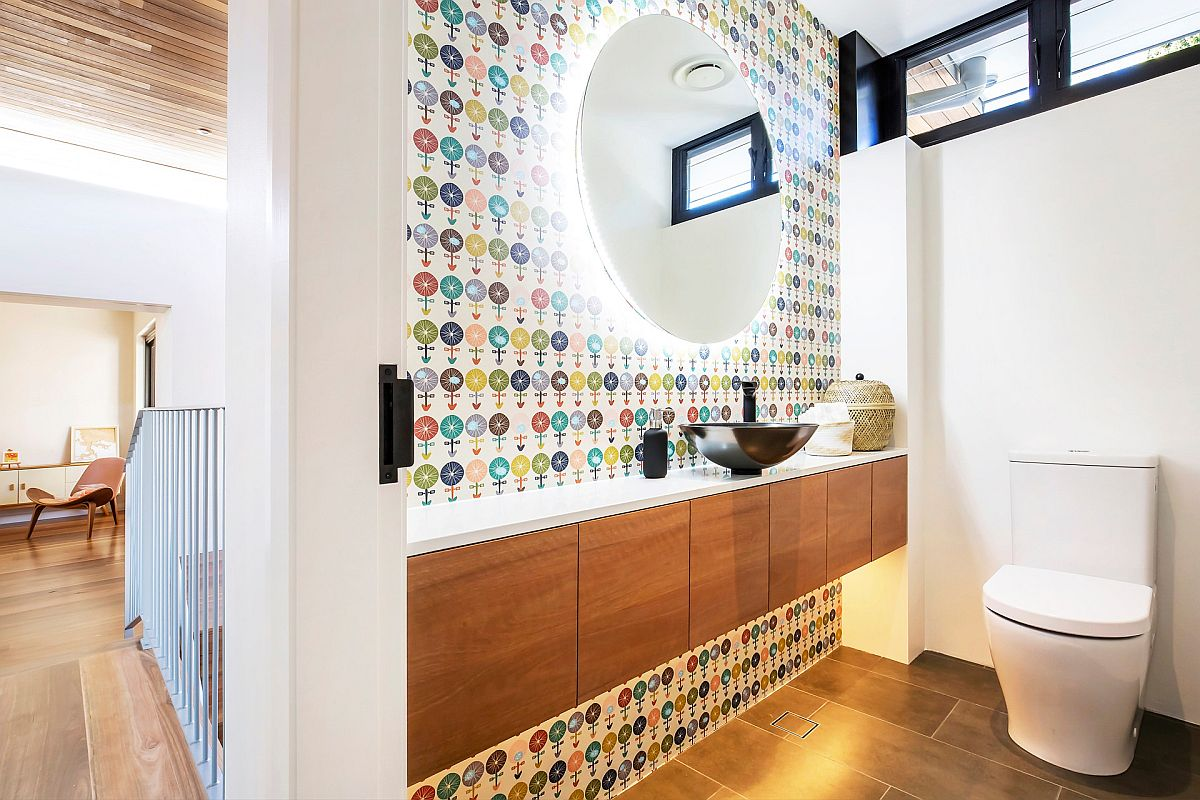 Explore different patterns and colors in the small modern powder room this year