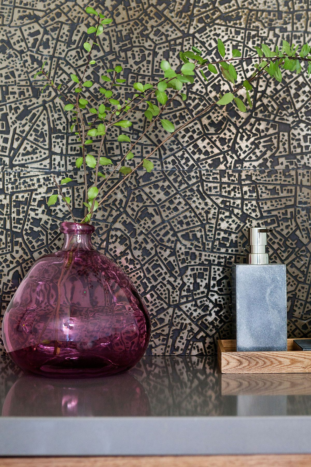 Find innovative ways to add greenery to the powder room using vases