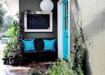 Gorgeous-blue-door-coupled-with-blue-cushions-on-the-bench-add-color-to-the-gray-and-white-exterior-37311-217x155