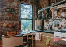 rustic overcrowded kitchen with brick wall