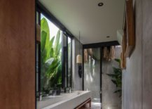 Large-banana-plants-outside-become-a-part-ofthe-modern-minimal-bathroom-in-here-87862-217x155