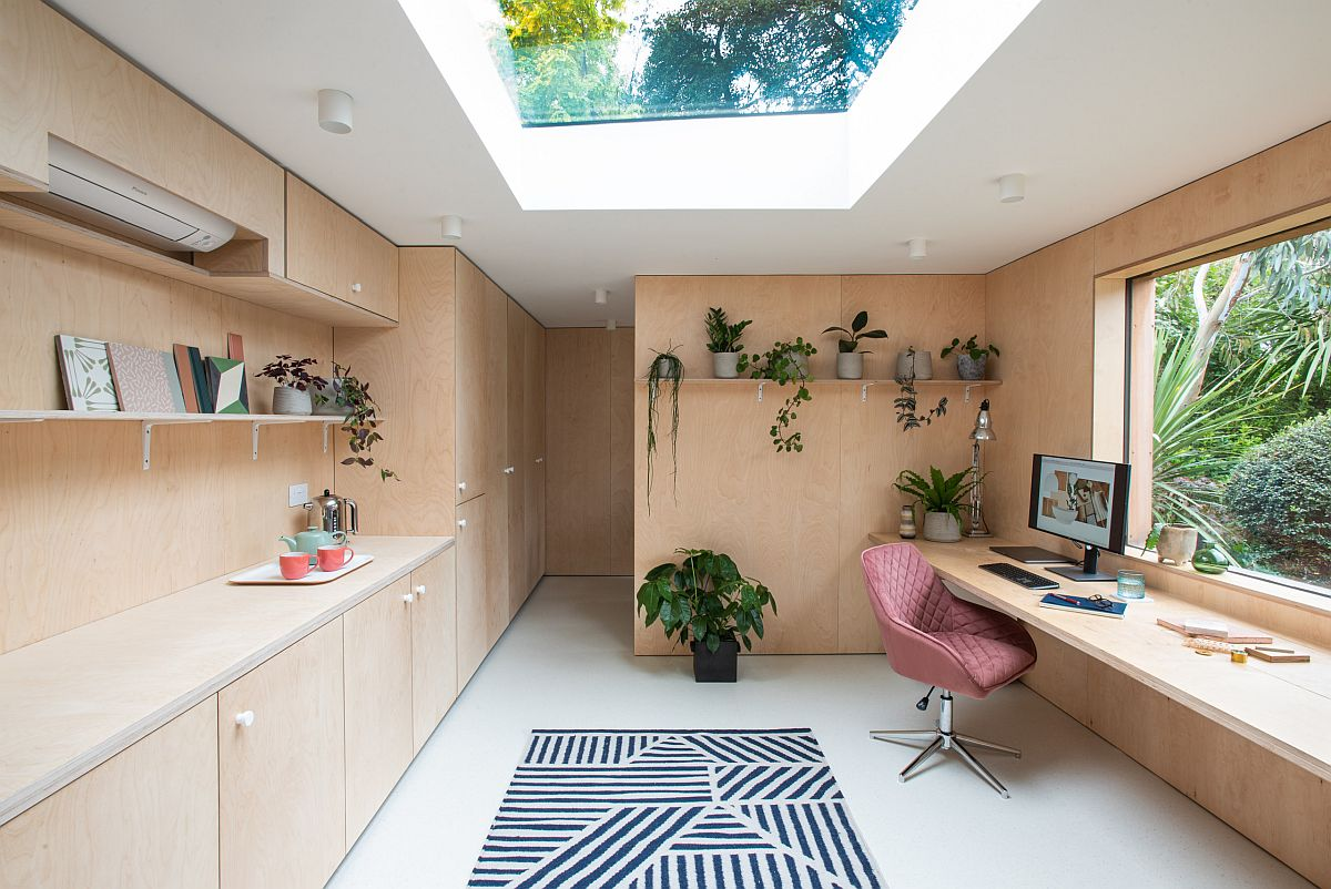 Large window and skylight usher light into this lovely home office