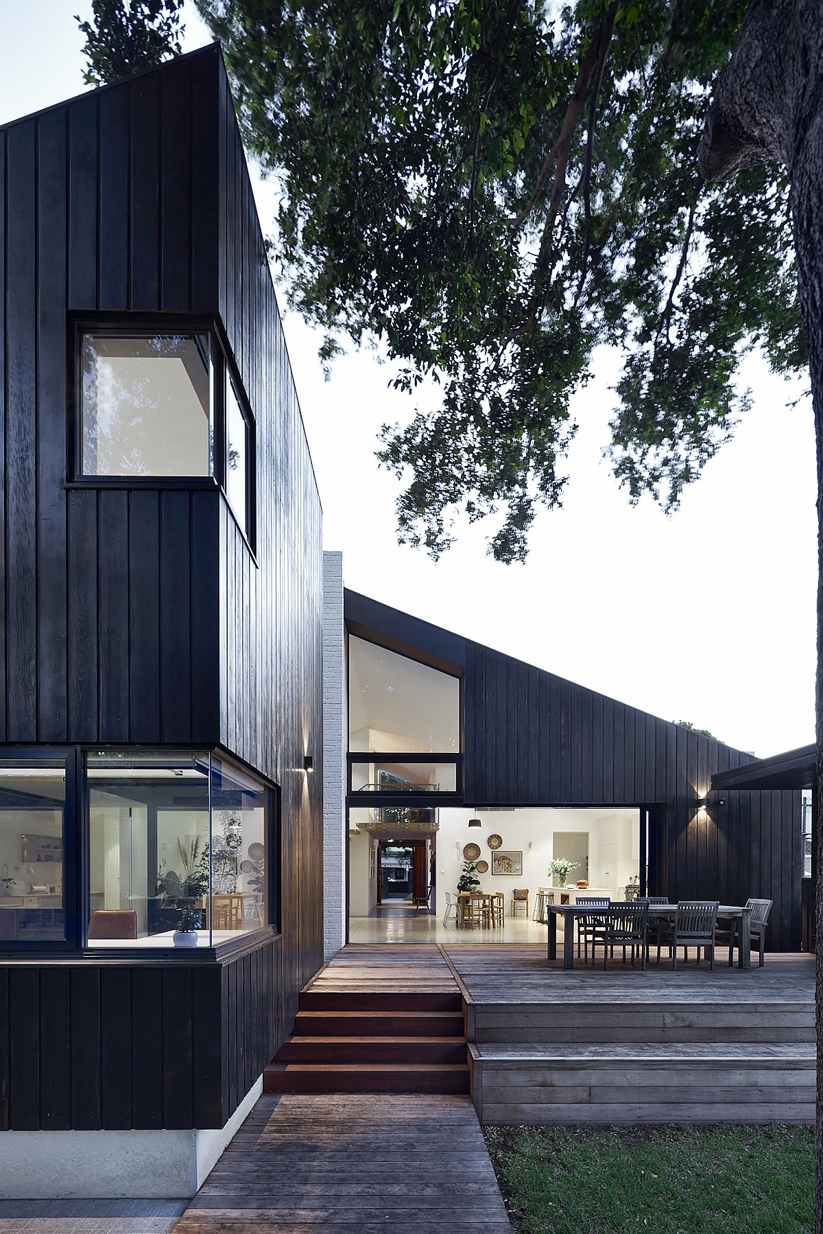 Large wooden deck extends the living area outdoors and connects the interior with the garden
