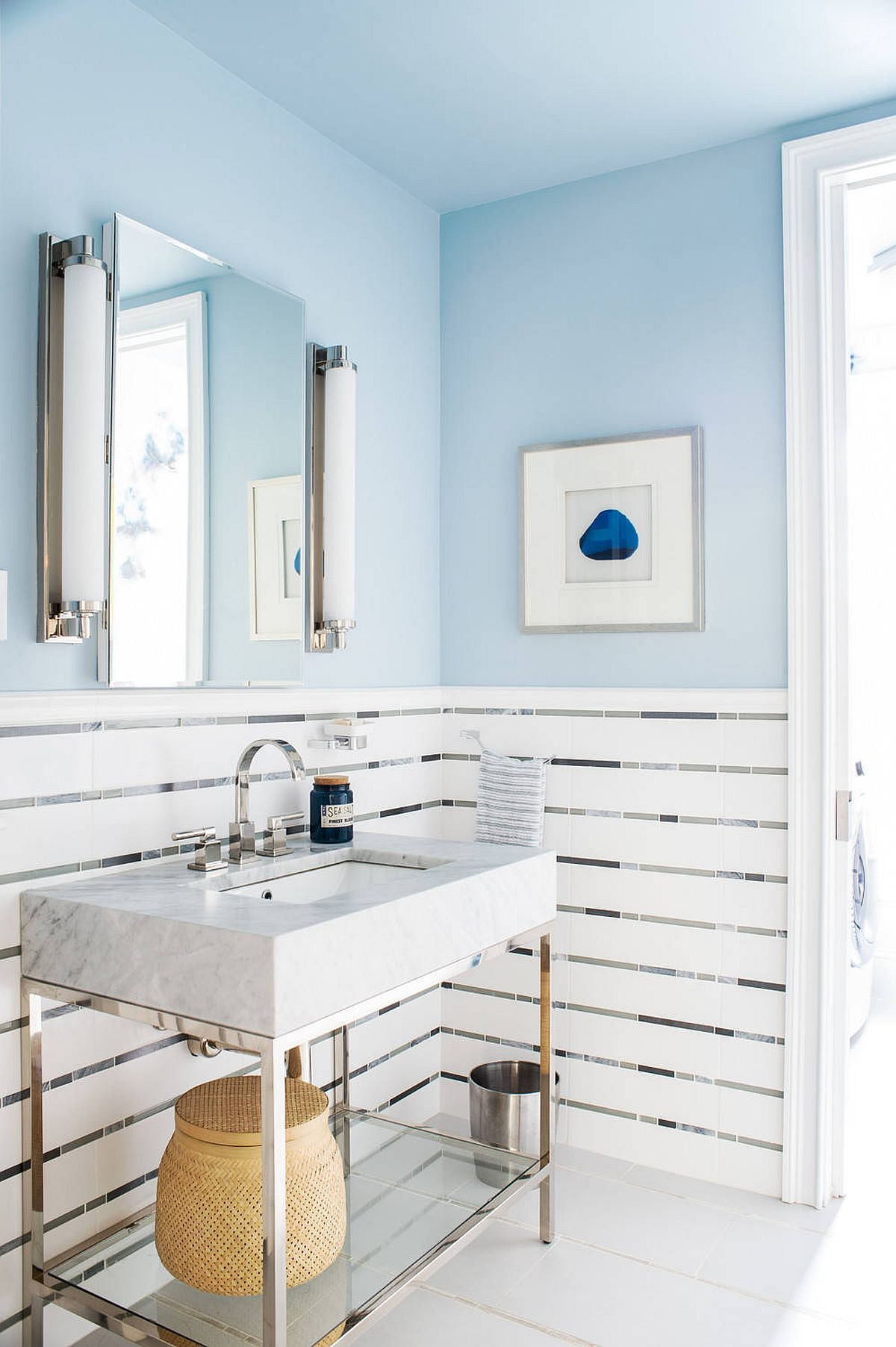Light blue coupled with white elegantly in the small beach style powder room