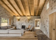 Living-area-of-the-cabin-with-stone-walls-and-a-sloped-wooden-ceiling-28557-217x155