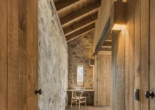 Long-corridors-inside-the-cabin-with-wooden-walls-and-cabinets-connecting-various-rooms-58109-217x155
