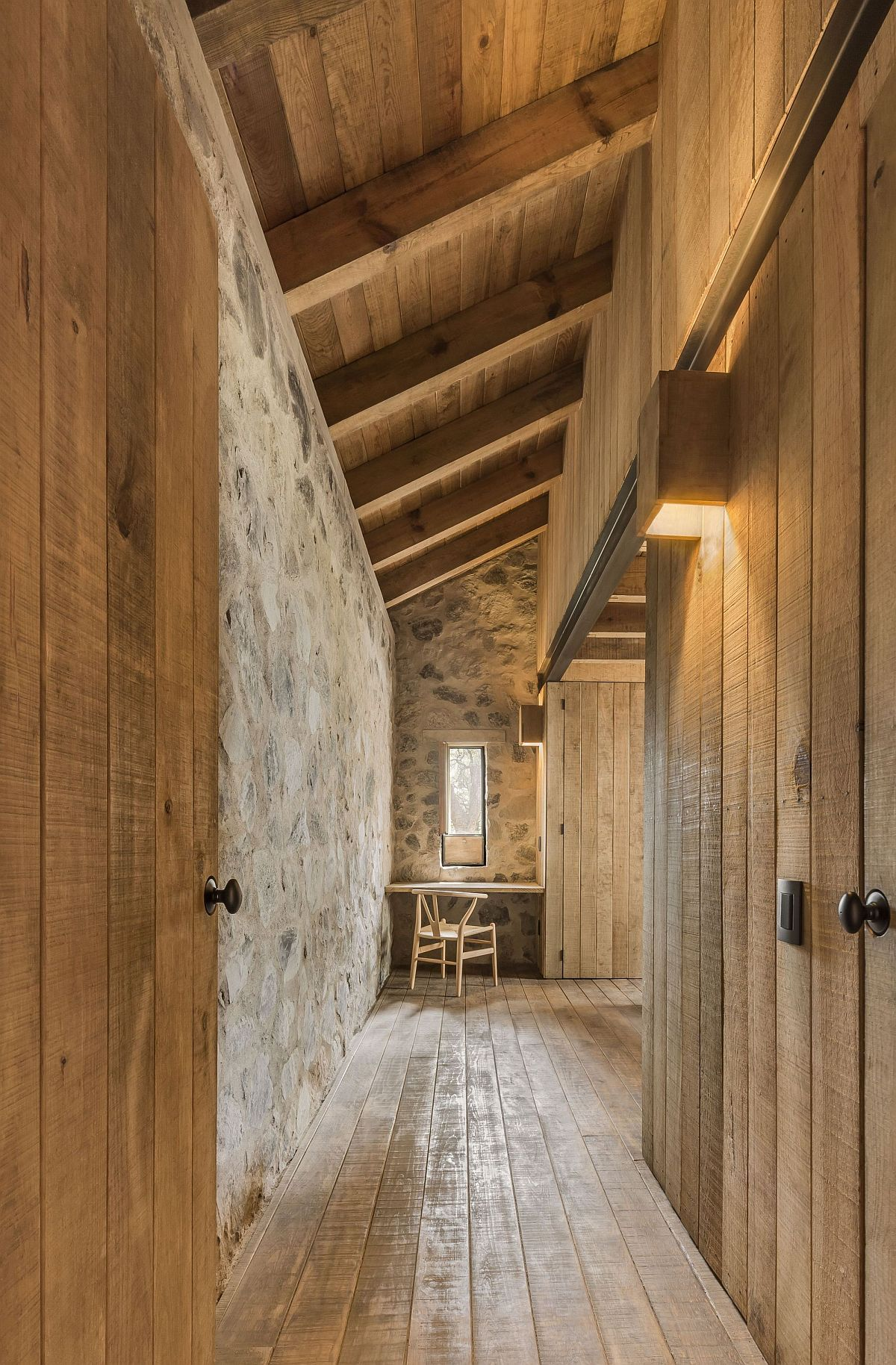 Long-corridors-inside-the-cabin-with-wooden-walls-and-cabinets-connecting-various-rooms-58109