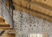 Look-at-the-interior-ofthe-stone-cabins-with-sloped-wooden-ceiling-16682-217x155
