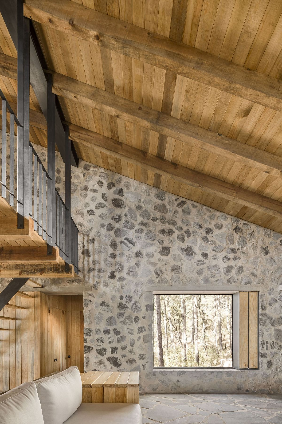 Look at the interior of the stone cabins with sloped wooden ceiling