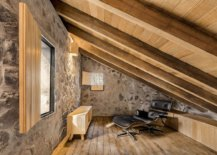 Low-and-sloping-roof-ofthe-room-leaves-little-space-for-the-Eames-lounger-and-the-small-wooden-console-18776-217x155
