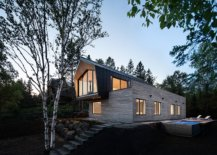 Metal-roofing-coupled-with-cedar-and-glass-creates-the-lovely-facade-of-the-house-78382-217x155