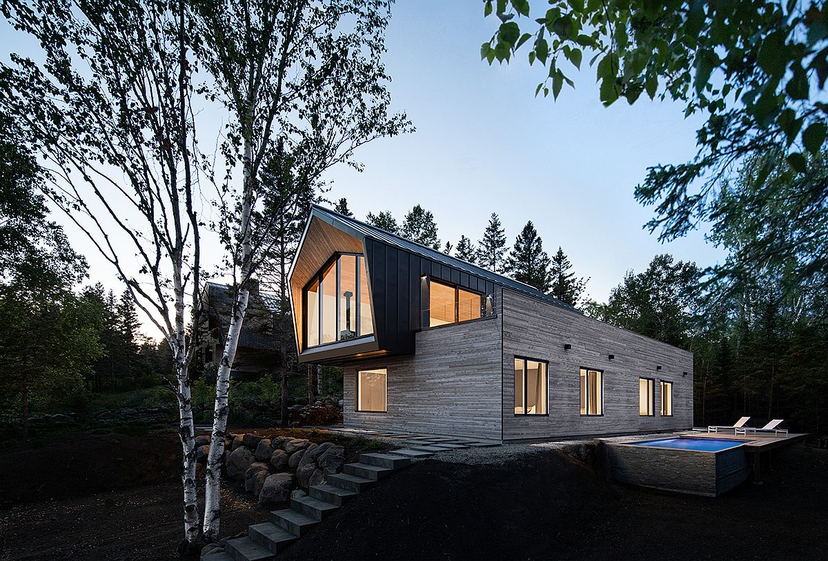 Metal-roofing-coupled-with-cedar-and-glass-creates-the-lovely-facade-of-the-house-78382