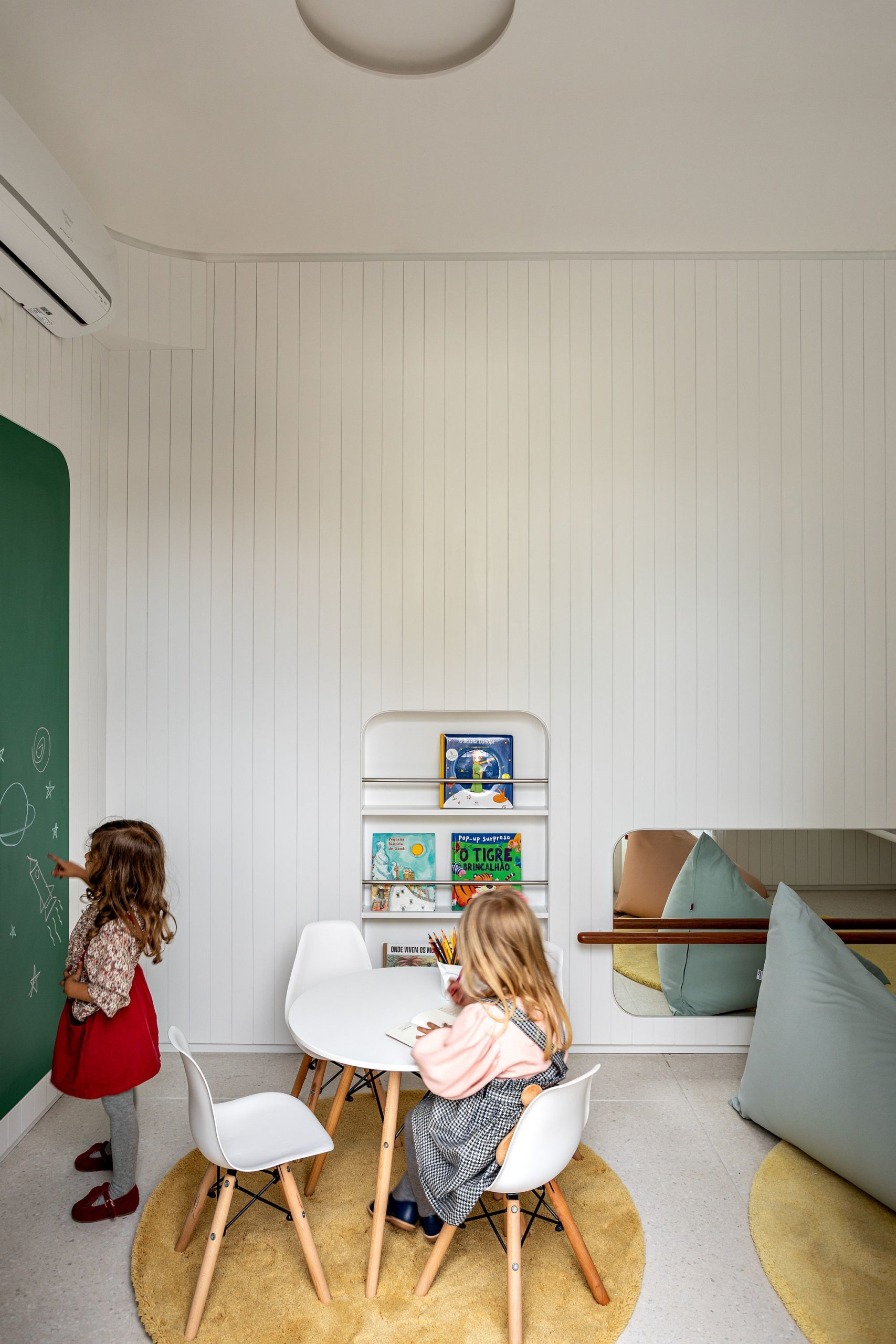 Modern kids' playarea in the common spaces of contemporary Brazilian building