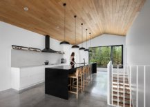 Modern-minimal-kitchen-in-wood-and-white-with-a-dark-island-23763-217x155