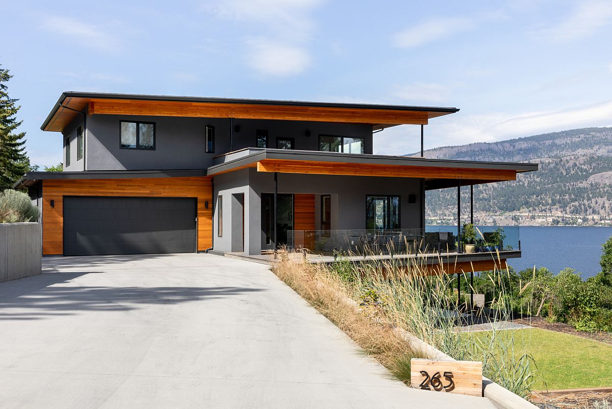 Mountain home with polished gray exterior that is accentuated by woodsy trims and shades