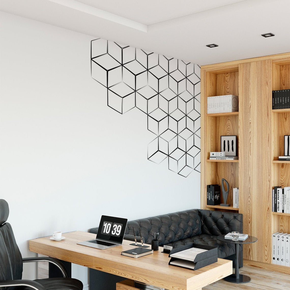 Office room with desk and black sofa