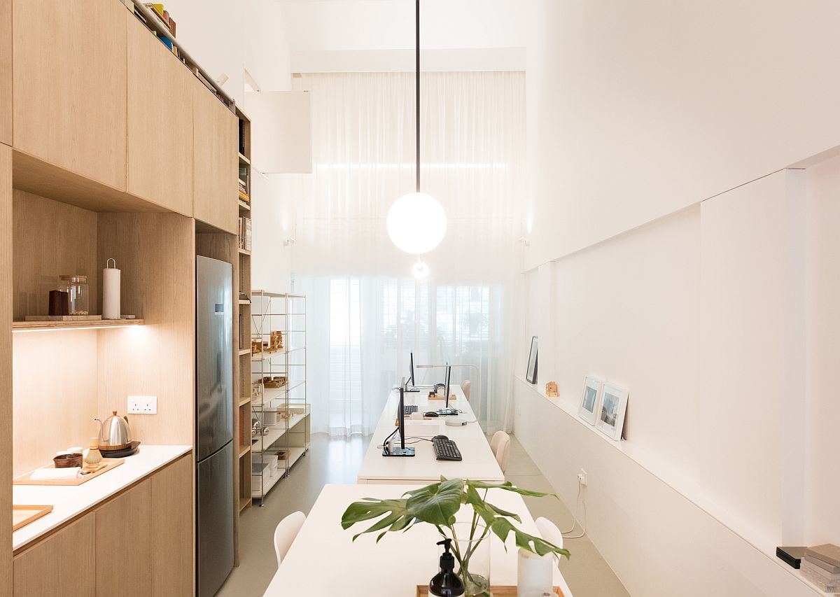 Office-space-with-smart-shelving-and-desks-that-can-easily-accomodate-a-couple-of-people-80381