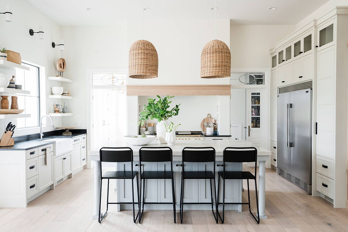 Pendants with a natural, organic finish elevate the beach style of this kitchen