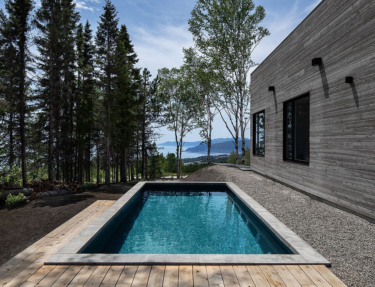 Relax-in-the-pool-and-on-the-deck-as-you-take-in-the-spectacular-view-outside-this-La-Malbaie-home-37881
