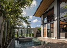 Relaxing-sunbed-at-the-center-of-the-pool-with-a-lovely-wooden-deck-next-to-it-93119-217x155