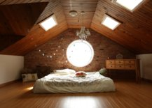 loft bedroom with slanted ceiling and skylight windows