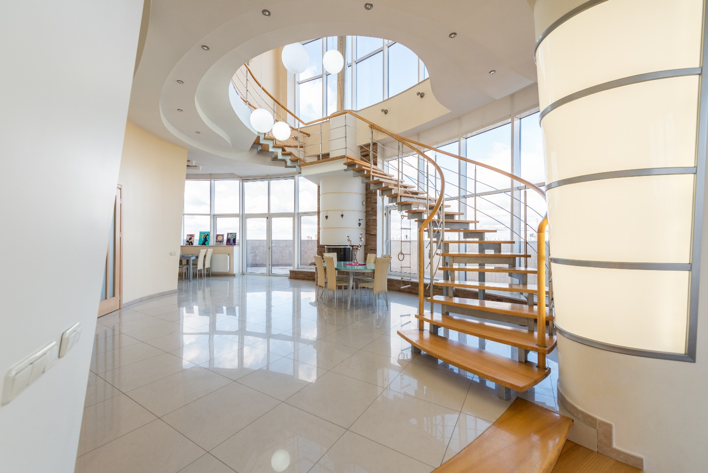 room with high ceiling and winding staircase