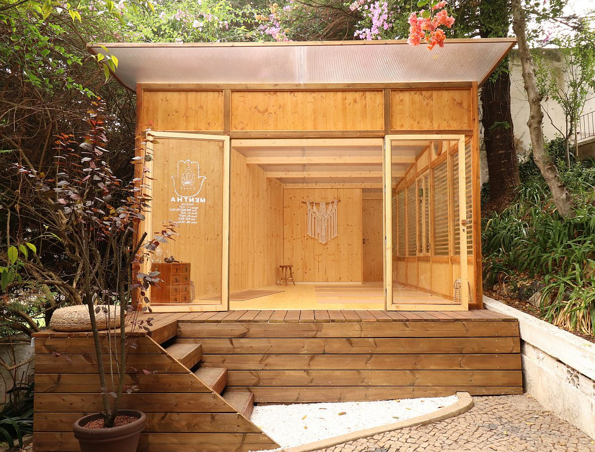 Serene and space-savvy modern garden yoga studio in wood and glass