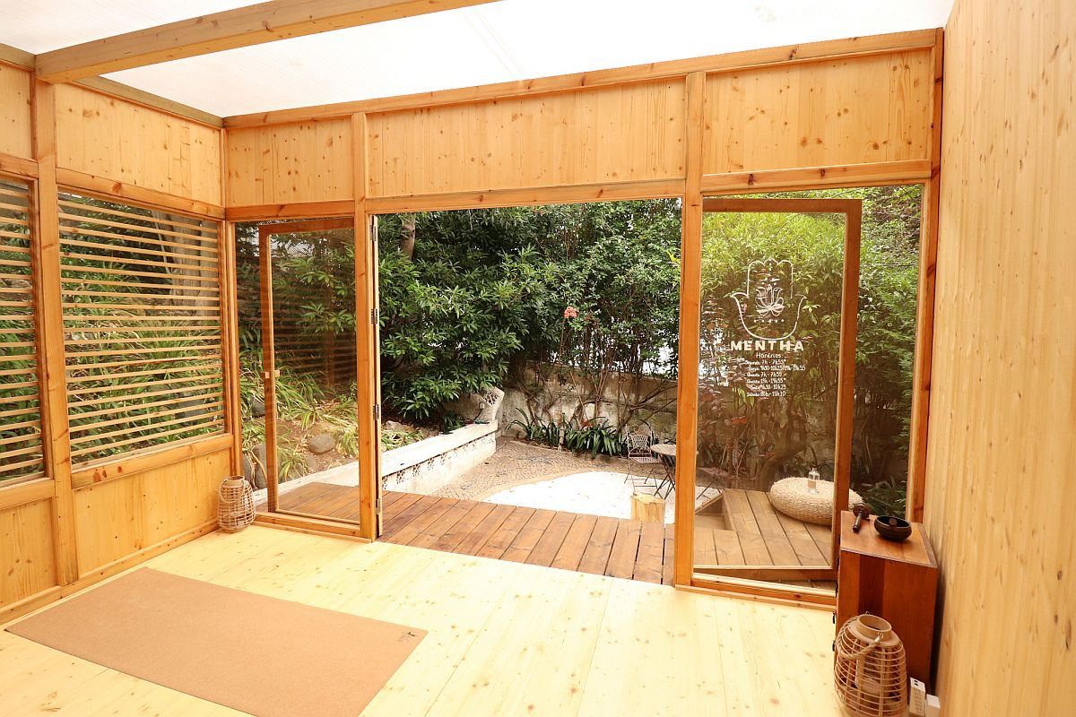 Small wooden deck outside the yoga studio extends the space beautifully