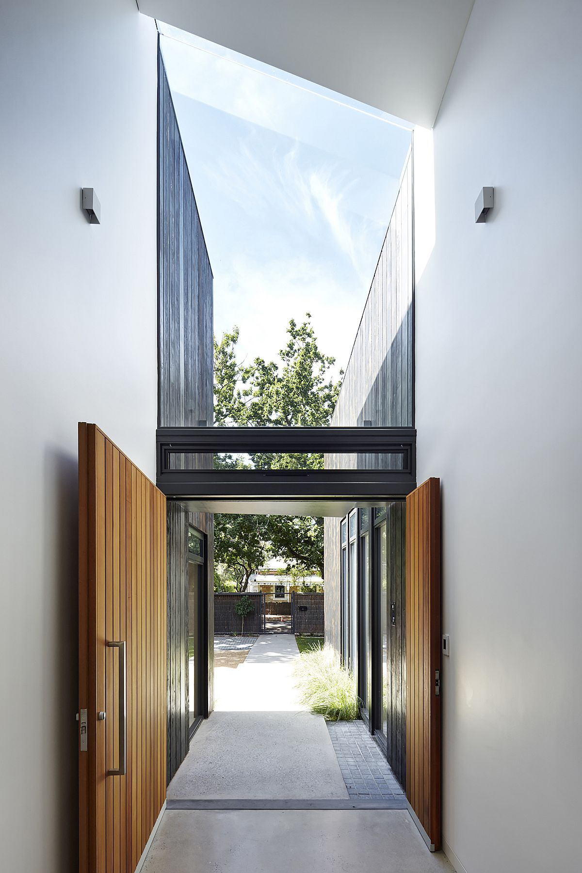Spacious and stylish entrance of the house in white