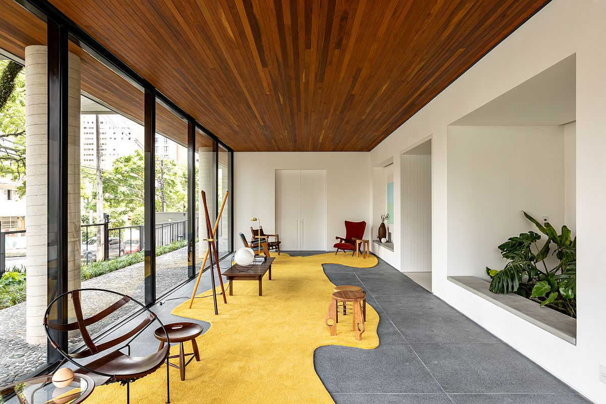 Striking and stylish hall of the common areas in Brazilian building with a bright yellow carpet