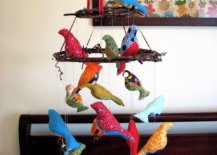 Stuffed birds hung on toy chandelier