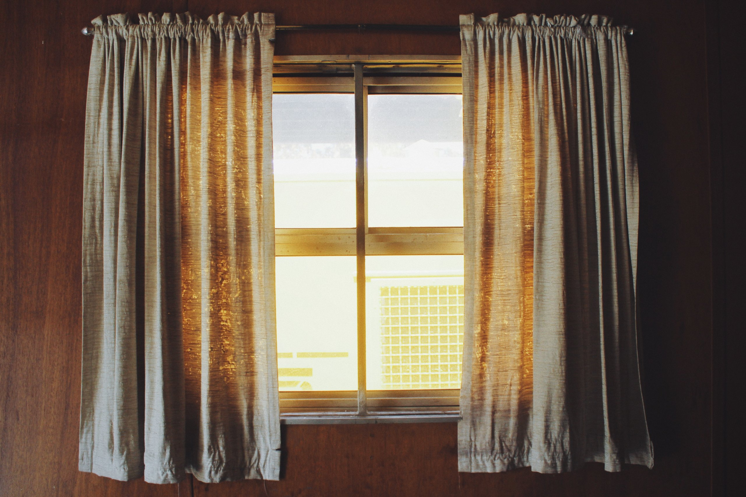burlap curtains infront of farmhouse window