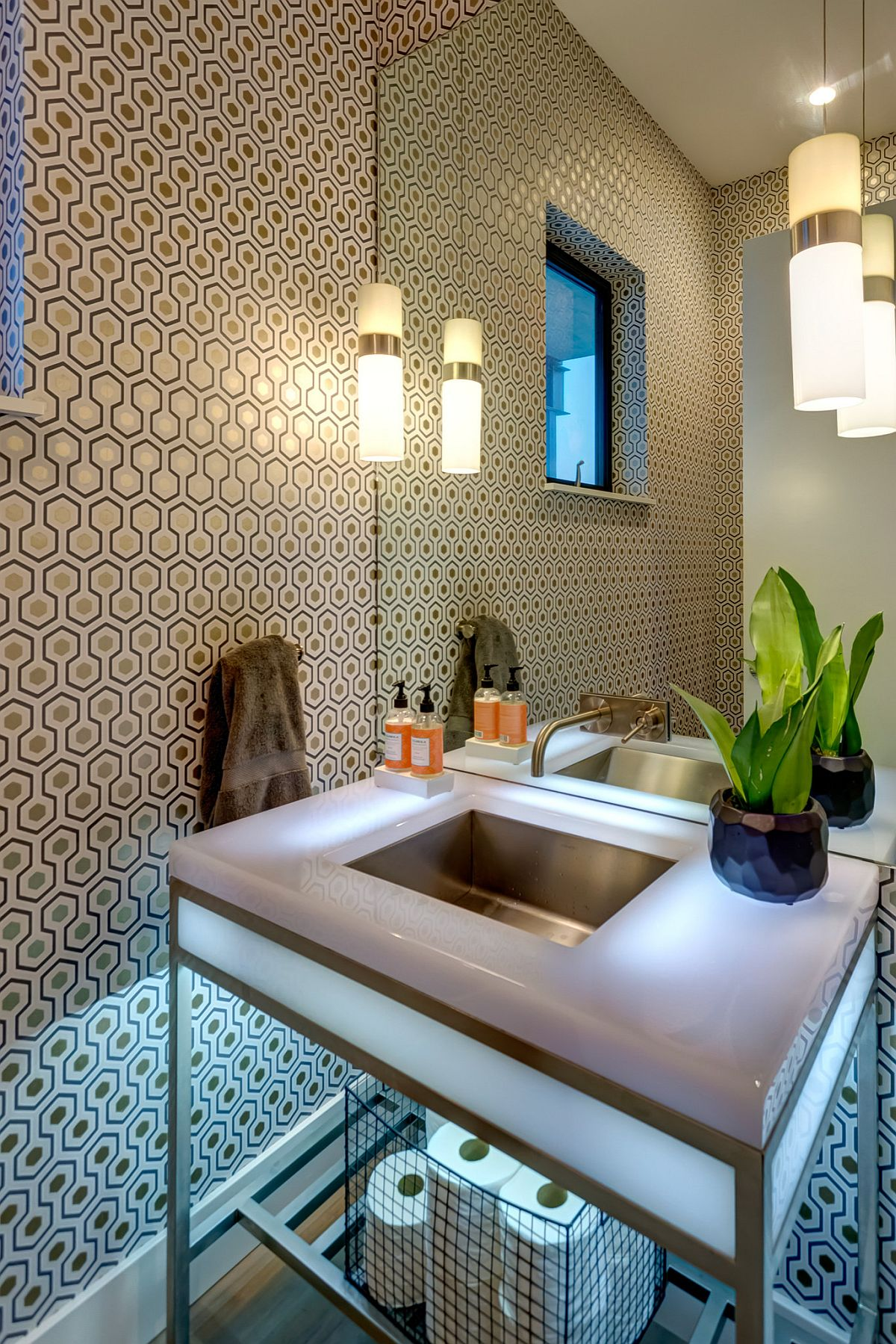 Wallpaper with iconic David Hicks pattern steals the spotlight in this small modern powder room
