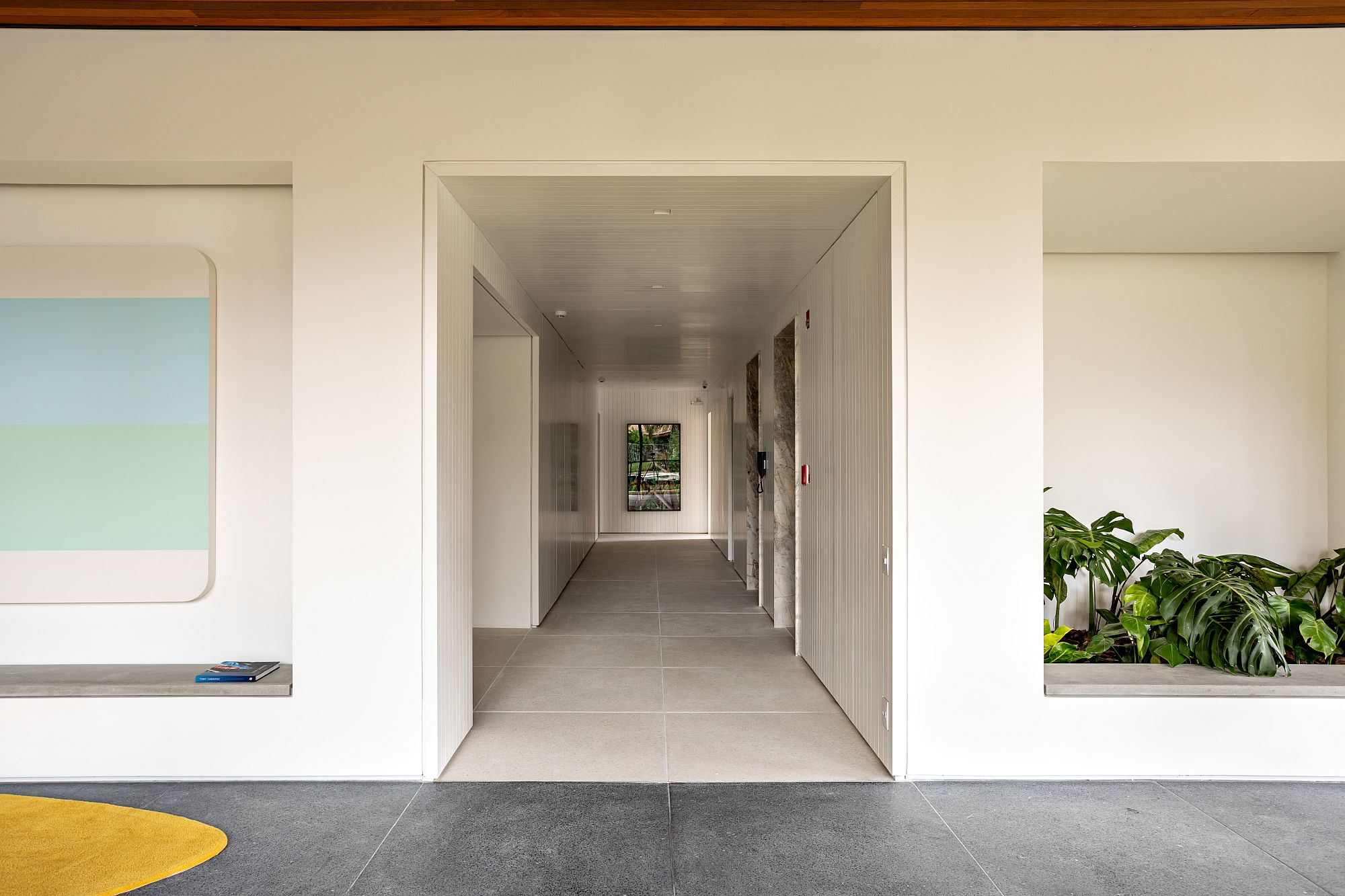 White corridor of the entry that leads to events spaces and the playareas