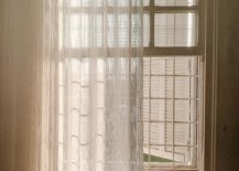 sheer curtain in front of french style window