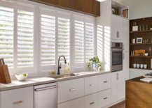 all white shutters in kitchen window