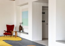White-walls-on-the-opposite-side-of-the-entrance-stand-in-contrast-to-the-floor-to-ceiling-glass-walls-49113-217x155