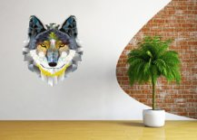 Wolf design on a wall with plant