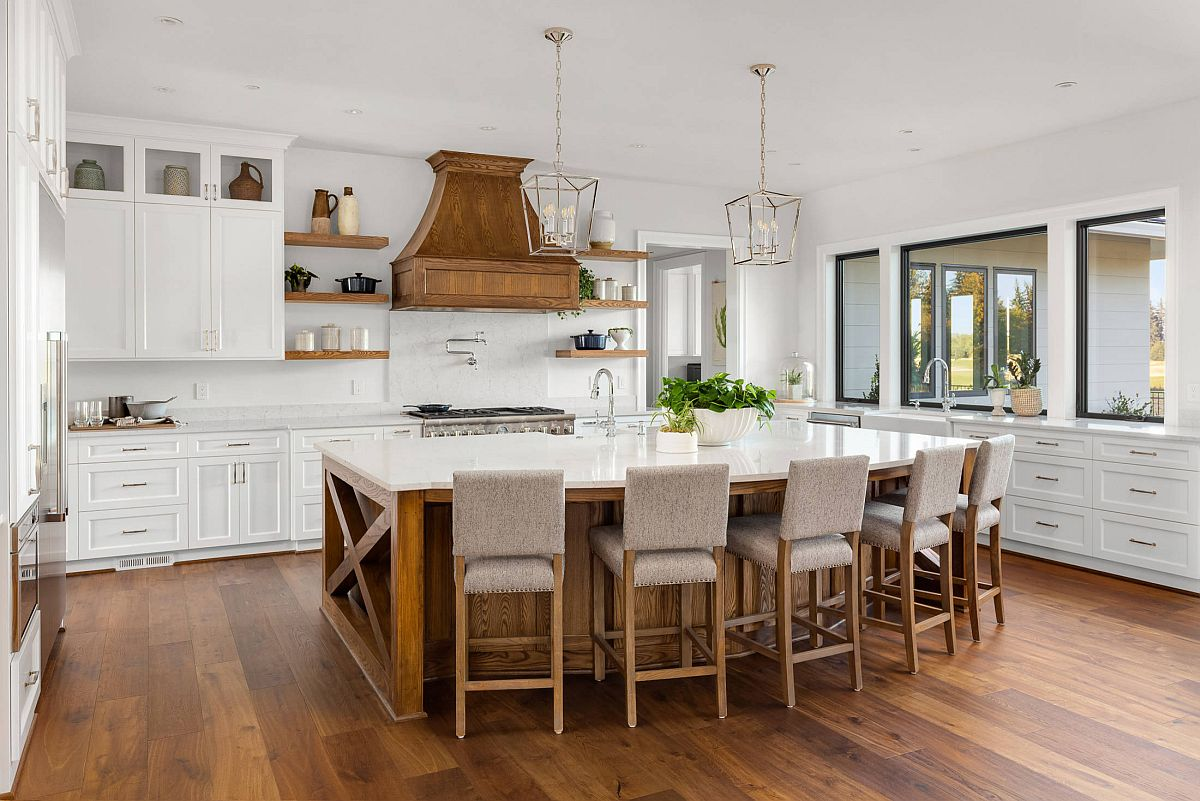 Wooden hood adds that something different to the white kitchen