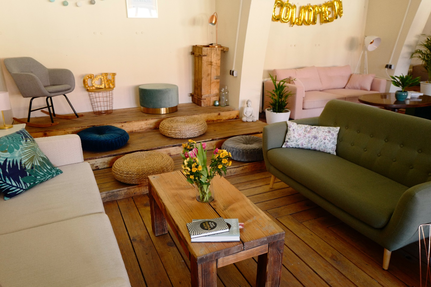 boho room with wood flooring and colorful furniture